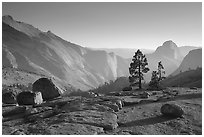 Erratic boulders, pines, Clouds rest and Half-Dome from Olmstedt Point, late afternoon. Yosemite National Park ( black and white)