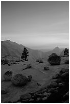 Glacial erratics, pine trees, Clouds rest and Half-Dome from Olmstedt Point, sunset. Yosemite National Park, California, USA. (black and white)