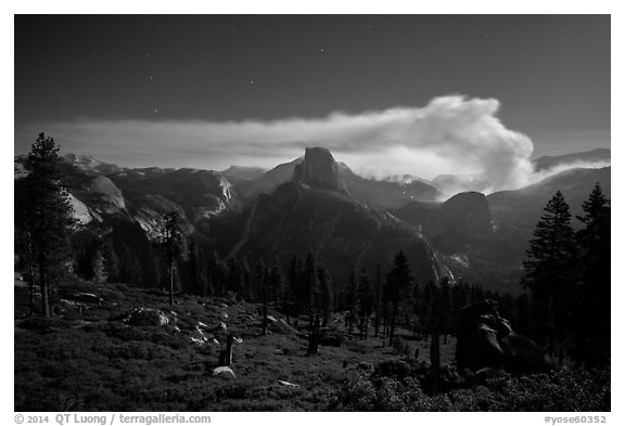Half-Dome and plume of smoke from forest fire at night. Yosemite National Park (black and white)