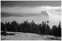 Half-Dome with fog clearing from Sentinel Dome. Yosemite National Park ( black and white)