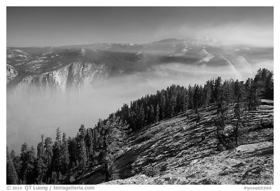 View from Sentinel Dome over fog-filed Valley. Yosemite National Park (black and white)