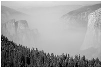 Smoky Yosemite Valley framed by Cathedral Rocks and El Capitan. Yosemite National Park ( black and white)