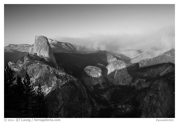 Half-Dome and forest fire from Washburn Point, late afternoon. Yosemite National Park (black and white)