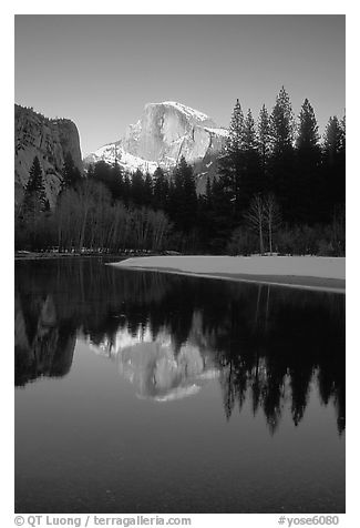 Half-Dome reflected in Merced River, winter sunset. Yosemite National Park (black and white)