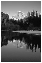 Half-Dome reflected in Merced River, winter sunset. Yosemite National Park, California, USA. (black and white)