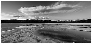 Snow-covered Twolumne Meadows and big cloud at sunset. Yosemite National Park (Panoramic black and white)