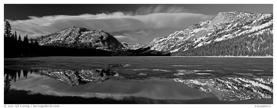 Mountains reflected in partly iced Tenaya Lake. Yosemite National Park (black and white)