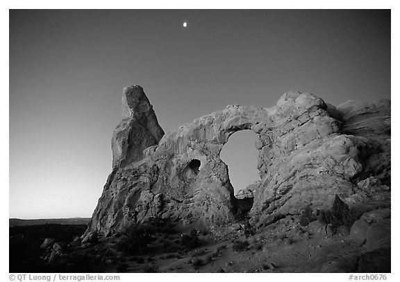 Turret Arch and moon, dawn. Arches National Park (black and white)
