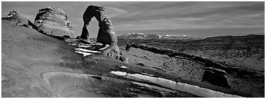 Delicate Arch and snowy mountain. Arches National Park (Panoramic black and white)