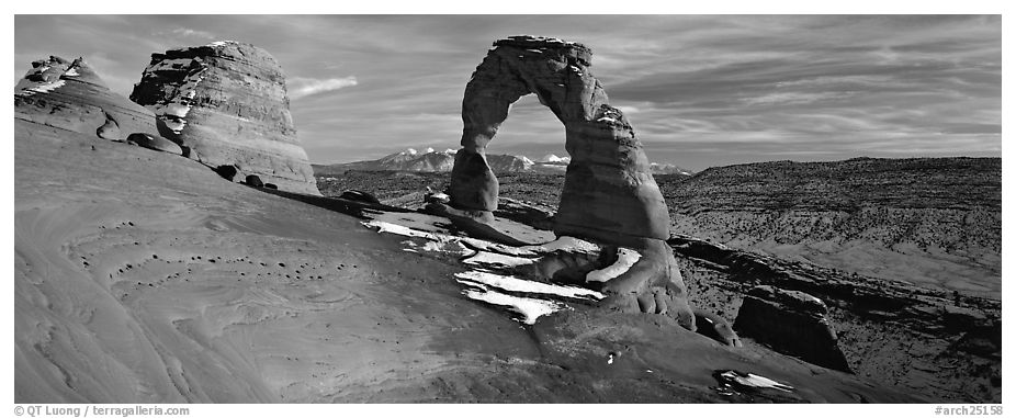 Red sandstone of Delicate Arch and blue shades of snow. Arches National Park (black and white)