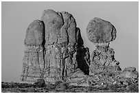 Balanced rock and sandstone tower. Arches National Park, Utah, USA. (black and white)