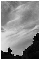Sunset clouds and small balanced rock. Arches National Park, Utah, USA. (black and white)