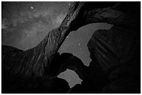 Double Arch at night with Milky Way. Arches National Park, Utah, USA. (black and white)