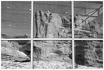 Sandstone walls, Visitor Center window reflexion. Arches National Park, Utah, USA. (black and white)