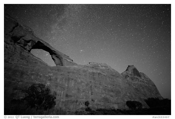 Skyline Arch at night with starry sky. Arches National Park (black and white)