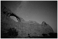 Skyline Arch at night with starry sky. Arches National Park, Utah, USA. (black and white)