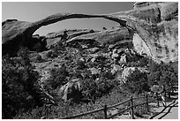 Visitor looking, Landscape Arch. Arches National Park, Utah, USA. (black and white)
