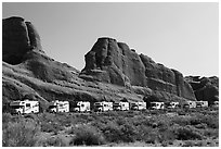 RVs parked at Devils Garden trailhead. Arches National Park, Utah, USA. (black and white)