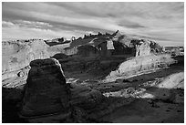 Winter Camp Wash and Delicate Arch at sunrise. Arches National Park, Utah, USA. (black and white)