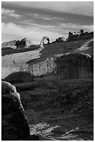 Delicate Arch atop steep cliff. Arches National Park, Utah, USA. (black and white)