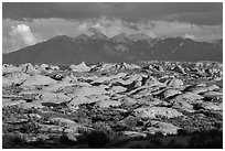Petrified dunes and cloudy La Sal mountains. Arches National Park, Utah, USA. (black and white)