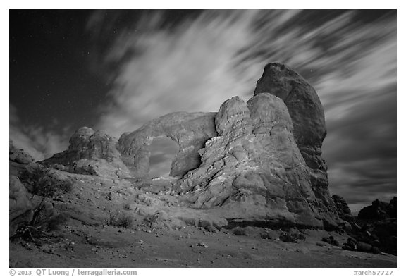 Turret Arch at night, lit by light. Arches National Park (black and white)
