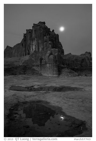 Courthouse tower and moon at night. Arches National Park (black and white)