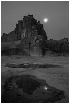 Courthouse tower and moon at night. Arches National Park, Utah, USA. (black and white)