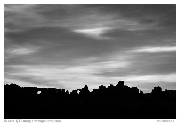 Windows and Turret Arch silhouetted at sunrise. Arches National Park (black and white)