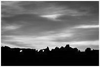 Windows and Turret Arch silhouetted at sunrise. Arches National Park ( black and white)