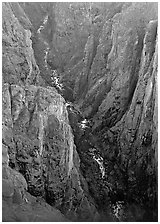 View down steep rock walls and narrow chasm. Black Canyon of the Gunnison National Park, Colorado, USA. (black and white)
