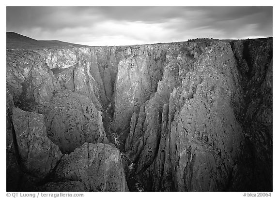 Narrow gorge under dark clouds. Black Canyon of the Gunnison National Park (black and white)
