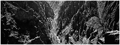 Gunnisson River running deep in narrow gorge. Black Canyon of the Gunnison National Park (Panoramic black and white)