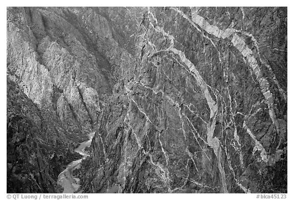 Sheer cliff with flourishes of crystalline pegmatite. Black Canyon of the Gunnison National Park (black and white)