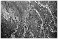 Sheer cliff with flourishes of crystalline pegmatite. Black Canyon of the Gunnison National Park, Colorado, USA. (black and white)