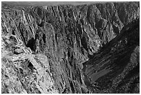 Visitor looking, Pulpit rock overlook. Black Canyon of the Gunnison National Park, Colorado, USA. (black and white)