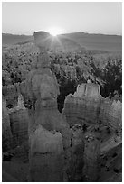 Sun rising behind Thor Hammer. Bryce Canyon National Park, Utah, USA. (black and white)
