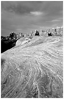 Sandstone striations and Needles near Elephant Hill, sunrise. Canyonlands National Park, Utah, USA. (black and white)