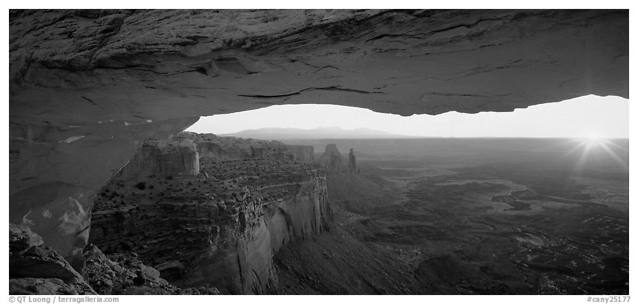 Sunrise and canyon landscape through Mesa Arch. Canyonlands National Park (black and white)