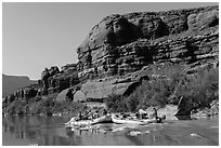 Rafts motoring upstream Colorado River. Canyonlands National Park, Utah, USA. (black and white)