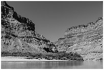 Cliffs towering above Confluence of Green and Colorado Rivers. Canyonlands National Park, Utah, USA. (black and white)