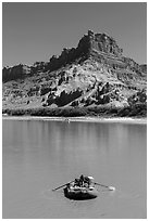 Woman paddling raft on Colorado River. Canyonlands National Park, Utah, USA. (black and white)