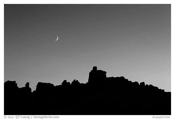 Crescent moon at sunset and Doll House spires. Canyonlands National Park (black and white)