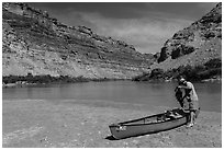 Canoeist and canoe near Confluence. Canyonlands National Park, Utah, USA. (black and white)