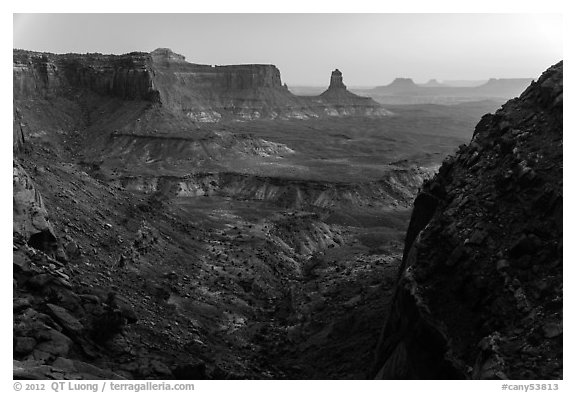 Cliffs and Candlestick Butte at dusk. Canyonlands National Park (black and white)
