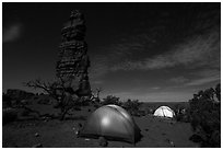 Tents at night below Standing Rock. Canyonlands National Park, Utah, USA. (black and white)