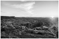 Sunrise over Jasper Canyon from Petes Mesa. Canyonlands National Park, Utah, USA. (black and white)