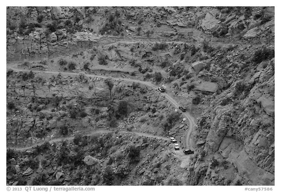 Jeep caravan negotiates hairpin turn on the Flint Trail,  Orange Cliffs Unit, Glen Canyon National Recreation Area, Utah. USA (black and white)