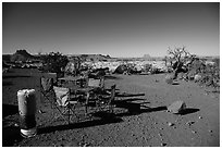Backcountry camp chairs and tables, Standing Rocks campground. Canyonlands National Park, Utah, USA. (black and white)