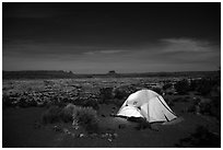 Tent overlooking the Maze at night. Canyonlands National Park, Utah, USA. (black and white)